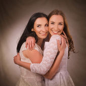 Two sisters smiling and hugging — Stock Photo