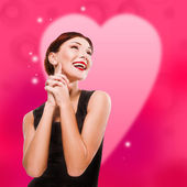 Smiling girl on pink background. Valentines day card — Stock Photo