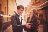 Loving couple embraces and laughs merrily — Stock Photo