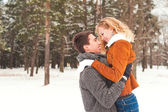 Young couple have a walk in the winter park — Stockfoto