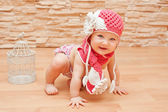 Little girl in pink knitted hat and scarf — Stock Photo