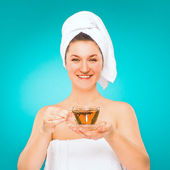 Spa salon. Young woman in towel with a cup of tea in her hand. — Stock Photo