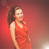 Stylized retro portrait of a young woman in red dress. — Stock Photo