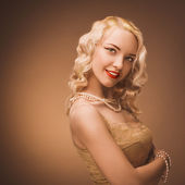 Retro portrait of a beautiful blonde woman. Vintage style. — Stock Photo