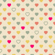Vintage retro seamless pattern with colorful hearts on cloth background — Stock Vector #46378775