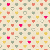 Vintage retro seamless pattern with colorful hearts on cloth background — Stock Vector
