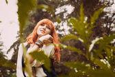 Redhead hippie walks in summer forest. — Stock Photo