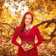 Apple woman. Very beautiful ethnic model eating red apple in the park. — Stock Photo
