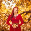 Apple woman. Very beautiful ethnic model eating red apple in the park. — Stock Photo #51557675