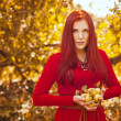 Apple woman. Very beautiful ethnic model eating red apple in the park. — Stock Photo #51558027