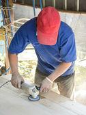 Carpenter s hands sanding plank using power — Stock Photo