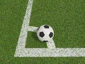 橄榄球或足球在康纳上绿草字段中 — 图库照片