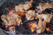 Pork steak on the grill with flames — Stock Photo