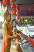 Water pouring to Buddha statue in Songkran festival tradition of thailand — Stock Photo