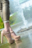 Nude pumps and snake pants — Stock Photo