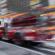 Fire trucks and firefighters brigade in the city — ストック写真