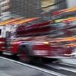 Fire trucks and firefighters brigade in the city — Stock fotografie