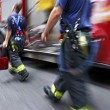 Fire trucks and firefighters brigade in the city — Stock Photo #34462701