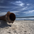 Rusty pipes along the sea beach — Stock Photo