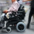 Stock Photo: Disabled on city street