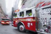 Fire trucks and firefighters brigade in the city — Stock Photo