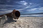 Rusty pipes along the sea beach — Stock Photo