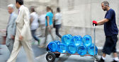 Delivery water with dolly — Stock Photo