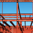 Steel beams against the blue sky. — Stock Photo