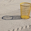 Yellow  bin on the  beach — Stock Photo