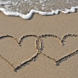 Images of hearts in the sand — Stock Photo #34711839