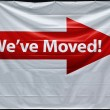"Stock Photo: Red arrow with ""we have moved"" inscription"