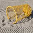 Yellow  bin on the  beach — Foto Stock