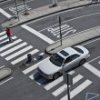 Car rides at a crosswalk — Stock Photo #34712965