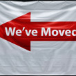 "Red arrow with ""we have moved"" inscription — Stock Photo"