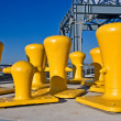 Stock Photo: Yellow mooring bollards