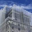 Multistorey building with construction for building — Stock Photo