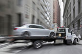 Tow truck delivers the damaged vehicle — Stock Photo