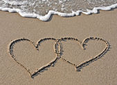 Images of hearts in the sand — Stockfoto