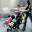 Mother with her baby in a stroller  — Foto Stock