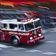 Stock Photo: Fire truck in action