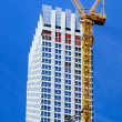 Building crane and building under construction — Stock Photo