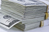 Stack of hundred dollar bills — Stock Photo