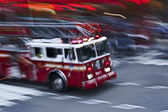 Fire truck in action — Stock Photo