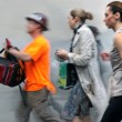 Motion blurred business people walking on the street — Stock Photo