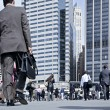 Business people walking on the street — Stock Photo