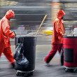 Stock Photo: Andmade cleaning garbage on city street