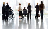 Group and disabled people in the lobby business center — Stockfoto