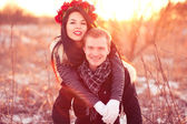 Happy young couple smiling and hugging — Stock Photo
