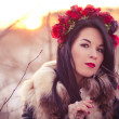 Winter girl with flowers — Stock Photo #40035723