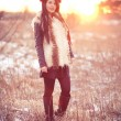 Young woman in fur vest — Stock Photo